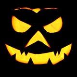 Gespenstischer Halloween-Kürbis-glänzendes Schwarzes Stockfoto