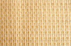 Gesponnenes Stroh placemat als Hintergrund Stockfotos