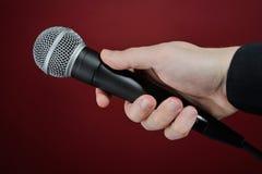 Gesprek met microfoon Royalty-vrije Stock Foto's