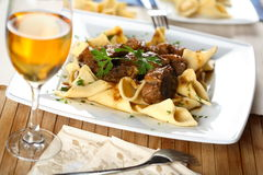 Gesse with pasta. Oven gesse with pasta and white wine Stock Photography