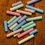 Gesso colorato su fondo di legno Fotografia Stock Libera da Diritti