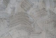 Gesso decorativo grigio di sollievo sulla parete, fondo di struttura Immagini Stock
