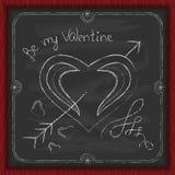 Gesso del fondo di giorno di biglietti di S. Valentino su una lavagna Fotografia Stock