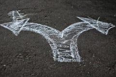 Gesso delle frecce su asfalto Fotografia Stock Libera da Diritti