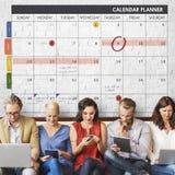 A gestão da organização do planejador do calendário lembra o conceito foto de stock