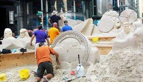Gestalten im Sand. Lizenzfreies Stockfoto