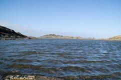 Gestalten Sie Fotografie von einem der bekanntesten Plätze in Menorca auf der Küste mit einem Leuchtturm landschaftlich lizenzfreie stockbilder