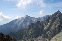 Gestalten Sie mit Bergspitzen im Sommer im hohen Tatras M landschaftlich Lizenzfreies Stockfoto