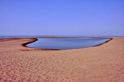 Einsamer sandiger Strand Lizenzfreies Stockbild