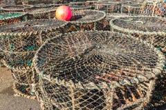Gestapelde zeekreeftnetten Stock Foto