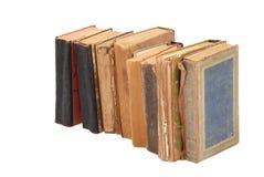 Gestapelte alte Bücher der unterschiedlichen Form und der Farbe Lizenzfreie Stockfotografie