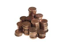 Gestapelte Münzen mit einen Pennys Stockfotografie