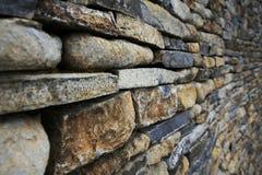 Gestapelte Steinwand Stockfotos