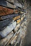 Gestapelte Steinwand Stockbild