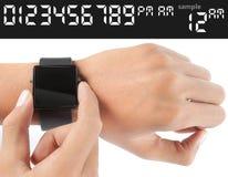 Geste de main de l'homme regardant dans la montre Images libres de droits
