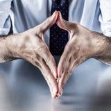 Geste de main pour le symbole de la stabilité, de la sécurité, de la symétrie ou de la réflexion Photographie stock libre de droits