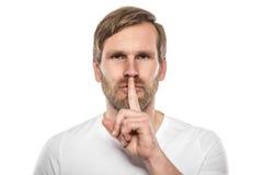 Geste tranquille silencieux d'homme avec le doigt photographie stock libre de droits