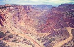 Gestemde de wijnoogst bekijkt Wit Rim Road in het Nationale Park van Canyonlands, stock afbeelding