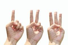Gestes de main comptant de 1 à 3 Photographie stock libre de droits