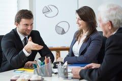 Gestión de la compañía durante la reunión de negocios Fotos de archivo libres de regalías