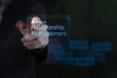 Gestión de la relación de show business de la mano del hombre de negocios Foto de archivo libre de regalías