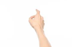 Gesticula o assunto: gestos de mão humanos que mostram a vista de primeira pessoa isolada no fundo branco no estúdio foto de stock