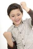 Gesticular bem sucedido do menino foto de stock
