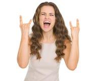 Gesticular da rocha da jovem mulher Imagem de Stock Royalty Free