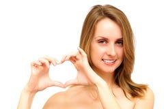 Gesticular do coração da mulher fotos de stock