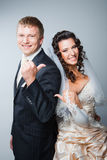Gesticulating bride and groom Royalty Free Stock Photography