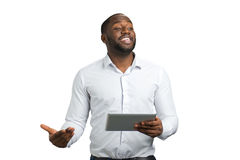 Gesticulating businessman with digital tablet. Royalty Free Stock Image