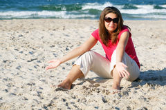 Gesticulating woman on the beach Stock Image