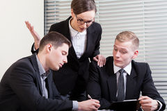 Gesticulating woman and their co-workers Stock Photo