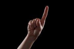 Gesticule, a mão da jovem mulher indica os dispositivos do sentido ou do toque Fotografia de Stock