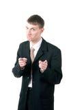 Gestikulieren des Mannes, der mit den Zeigefingern darstellt Lizenzfreies Stockfoto