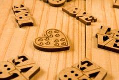 Gestileerd beeld van de inschrijving van liefde als symbool van liefde en toewijding stock foto