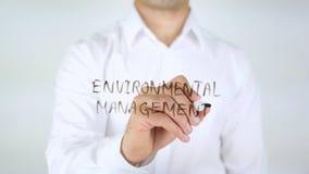 Gestione ambientale, scrittura dell'uomo sul vetro Immagini Stock Libere da Diritti
