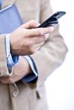Gestionnaire avec le téléphone portable Image stock