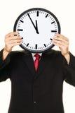 Gestionnaire d'horloge devant la tête avec la tension Images libres de droits