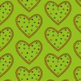 Gestippeld groen hart naadloos patroon op een groene achtergrond Stock Afbeeldingen