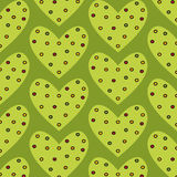 Gestippeld groen hart naadloos patroon op een groene achtergrond Royalty-vrije Stock Fotografie