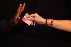 Gesto da corrupção da corrupção com dinheiro à mão Imagens de Stock Royalty Free