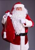 Gesto de Claus em um saco Imagem de Stock Royalty Free