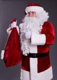 Gesto de Claus em um saco imagem de stock