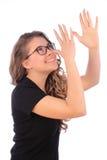 Gesto de la muchacha del adolescente y tomadura de pelo Fotografía de archivo