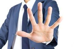 Gesto de Stop Sign Hand del hombre de negocios aislado en el fondo blanco fotos de archivo