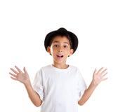 Gesto del muchacho con el sombrero negro aislado en blanco Imagen de archivo