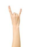 Gesto della roccia di rappresentazione della mano del ` s della donna Fotografie Stock