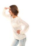 Gesto di sorveglianza della donna attraente sopra un bianco Fotografia Stock