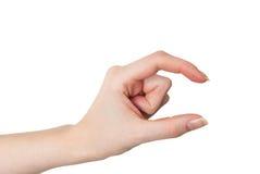Gesto femminile della tenuta o di misurazione della mano isolato immagini stock libere da diritti